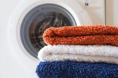 Washing machine and towels Stock Photo