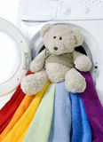 Washing machine, toy and color things to wash. Washing machine, toy and colorful things to wash Stock Photos