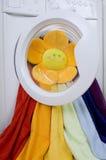 Washing machine, toy and colorful laundry to wash Stock Image