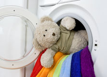 Washing machine, toy and colorful laundry to wash Royalty Free Stock Photos