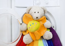 Washing machine, toy and colorful laundry to wash Stock Images