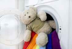 Washing machine, toy and colorful laundry to wash Royalty Free Stock Photo