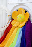 Washing machine, toy and colorful laundry to wash Royalty Free Stock Images