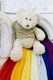 Washing machine, toy and colorful things to wash Royalty Free Stock Photo