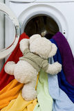 Washing machine, toy and colorful things to wash Stock Images