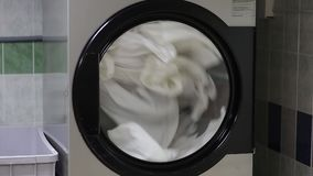 Washing machine wash white linen. stock video