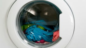 Washing machine is washing clothes stock video footage