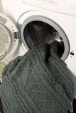 Washing machine with wool sweater Royalty Free Stock Images