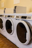 Washing machines. Row of commercial washing machines in laundromat Royalty Free Stock Image