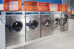 Washing Machines And Empty Baskets In A Row Stock Images