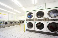 Washing machines in empty public laundry Royalty Free Stock Photo