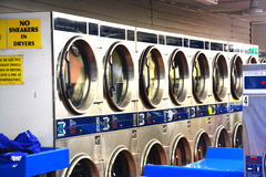 Washing machines inside laundry shop or launderette royalty free stock photos