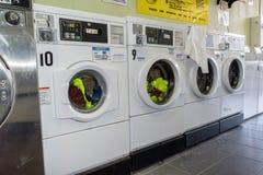 Washing machines at laundromat stock photos