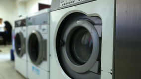 Washing machines in laundry room, close-up Stock Images