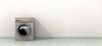 Washing MAching In An Empty Room. A front view of a regular brushed metal washing machine in an empty tiled room Stock Photo