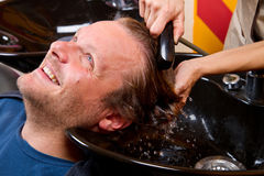 Washing man hair Royalty Free Stock Photo