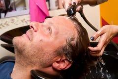 Washing man hair. In beauty parlour hairdressing salon Royalty Free Stock Photos