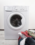 Washing mashine with detergent and laundry Royalty Free Stock Photography