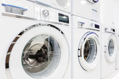 Washing mashines in appliance store. Washing machines, dryer and other domestic appliance equipment in the store Stock Image