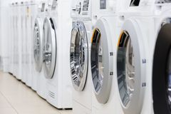 Washing mashines in appliance store stock images