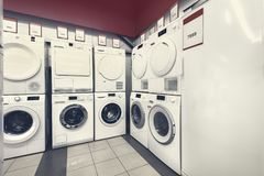 Washing mashines in appliance store stock photography