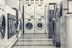 Washing mashines in appliance store royalty free stock photography
