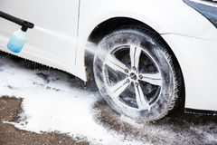 Washing modern car with high pressure water Royalty Free Stock Image