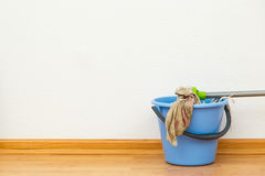 Washing mop with blue bucket Stock Photo
