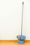 Washing mop with blue bucket Stock Photography