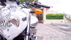 Washing motorbike. With soap suds Royalty Free Stock Photography