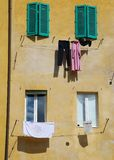Washing Outside Yellow Building Royalty Free Stock Images