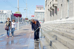 Washing the pavement Stock Images