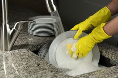 Washing a plates Royalty Free Stock Photography