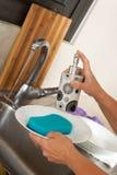 Washing plates . Close-up. Stock Images