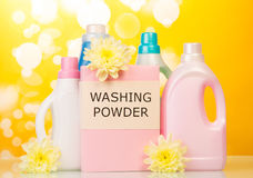 Washing powder and Cleaning items on yellow Stock Photography