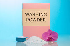 Washing powder, meashuring cup and flower Stock Images
