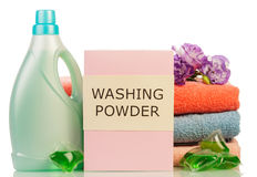 Washing powder and towels Stock Images