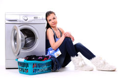 Washing. A pretty young woman doing laundry Stock Photography