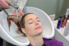 Washing procedure at hairdressers Stock Photo
