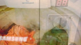 Washing process in the Washing machine paid with. Process in washing machine with coin operated. Time lapse speed up stock footage