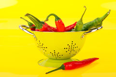 Washing red and green peppers Royalty Free Stock Images