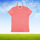 Washing red tshirt Royalty Free Stock Images