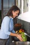 Washing salad Royalty Free Stock Image