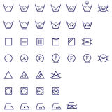 Washing signs icon set. An illustration of washing , cloth symbols of ironing, washing ,drying and bleaching Royalty Free Stock Photos