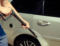 Washing silver car with pressurized water. close up. Washing silver car with pressurized water Stock Photography