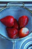 Washing strawberries Royalty Free Stock Photos