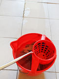 Washing the tile floor by mop Stock Photography