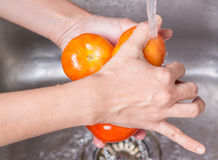 Washing Tomatoes Stock Images