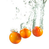 Washing tomatoes Royalty Free Stock Photo