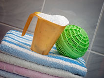 Washing tools. Two different ways of clothes washing, with detergents and a modern ball washer Royalty Free Stock Image